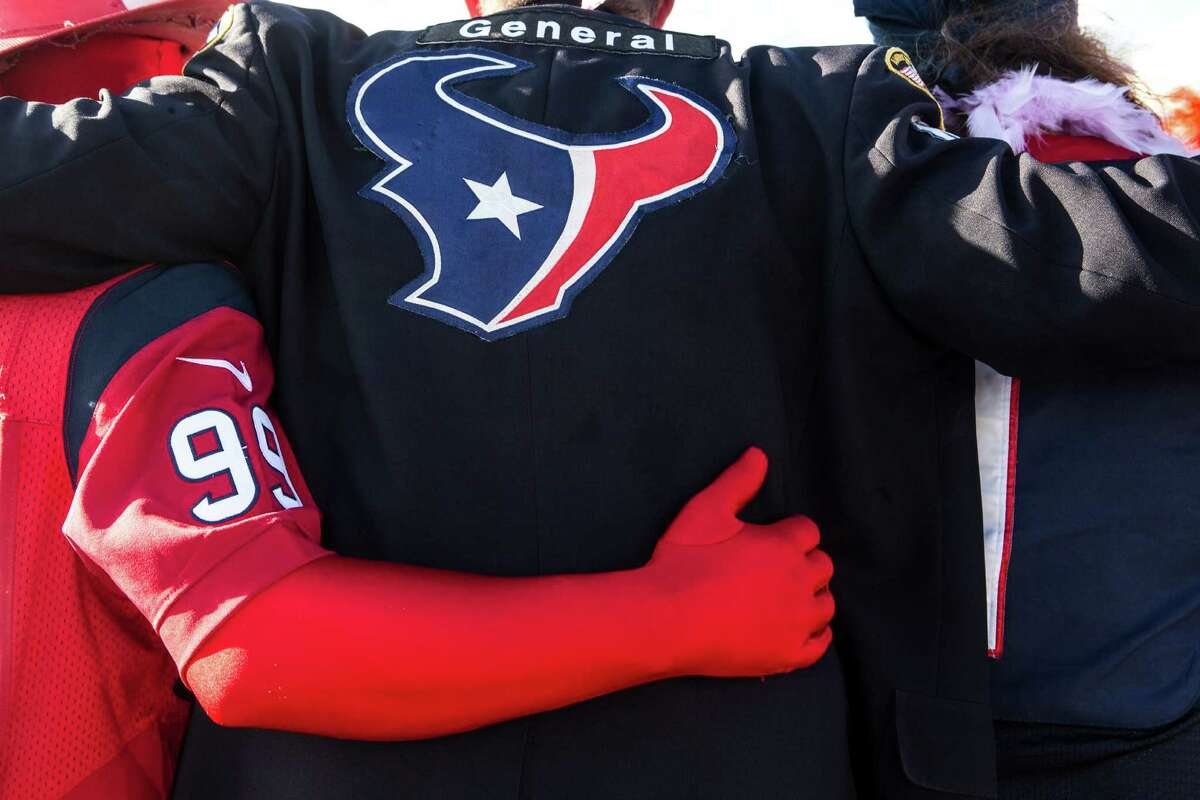 Houston Texans fans tailgate outside NRG Stadium before an NFL football game between the Texans and the Indianapolis Colts on Sunday, Oct. 16, 2016, in Houston.