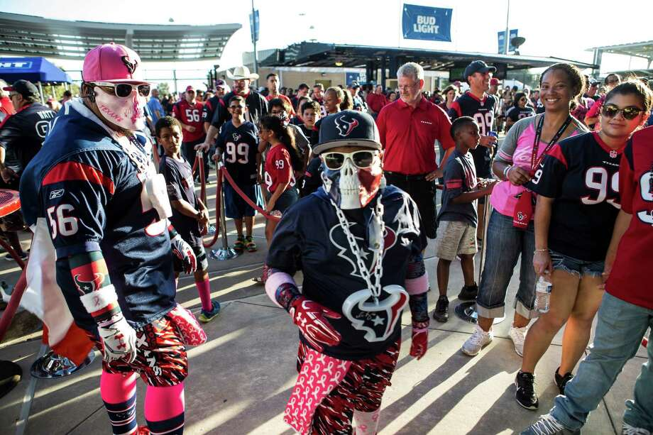 Houston Texans fans walk outside NRG Stadium as they arrive for an NFL football game between the Texans and the Indianapolis Colts on Sunday, Oct. 16, 2016, in Houston. Photo: Brett Coomer, Houston Chronicle / © 2016 Houston Chronicle