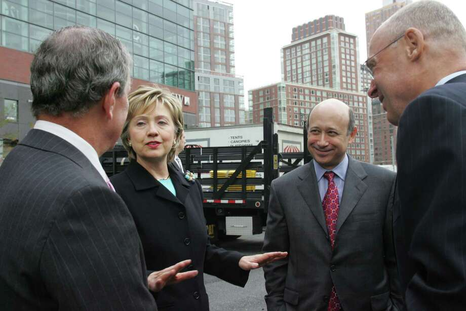 FILE -- From left: New York City Mayor Michael Bloomberg, Sen. Hillary Clinton (D-N.Y.) Lloyd Blankfein, Goldman Sachs' president and chief operating officer, and Henry Paulson Jr., Goldman Sachs' chairman and chief executive, at the groundbreaking of the company's headquarters in New York, Nov. 29, 2005. Goldman Sachs, one of the country's most powerful financial firms, and the Clintons, one of the most famous political families, have a long-running and mutually beneficial relationship. (Marilynn K. Yee/The New York Times) ORG XMIT: XNYT83 Photo: MARILYNN K. YEE / NYTNS