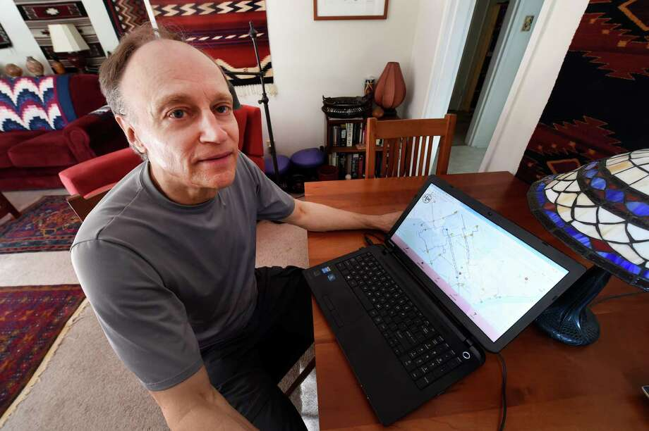 Glenn Sandberg demonstrates the new bike map software on his computer Friday Oct. 14, 2016 in Albany ,  N.Y.  (Skip Dickstein/Times Union) Photo: SKIP DICKSTEIN / 20038382A