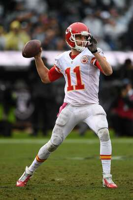 OAKLAND, CA - OCTOBER 16:  Alex Smith #11 of the Kansas City Chiefs looks to pass against the Oakland Raiders during their NFL game at Oakland-Alameda County Coliseum on October 16, 2016 in Oakland, California.  (Photo by Thearon W. Henderson/Getty Images)