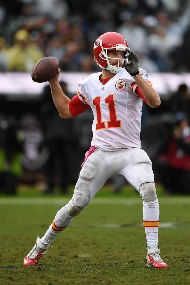 OAKLAND, CA - OCTOBER 16:  Alex Smith #11 of the Kansas City Chiefs looks to pass against the Oakland Raiders during their NFL game at Oakland-Alameda County Coliseum on October 16, 2016 in Oakland, California.  (Photo by Thearon W. Henderson/Getty Images) Photo: Thearon W. Henderson, Getty Images