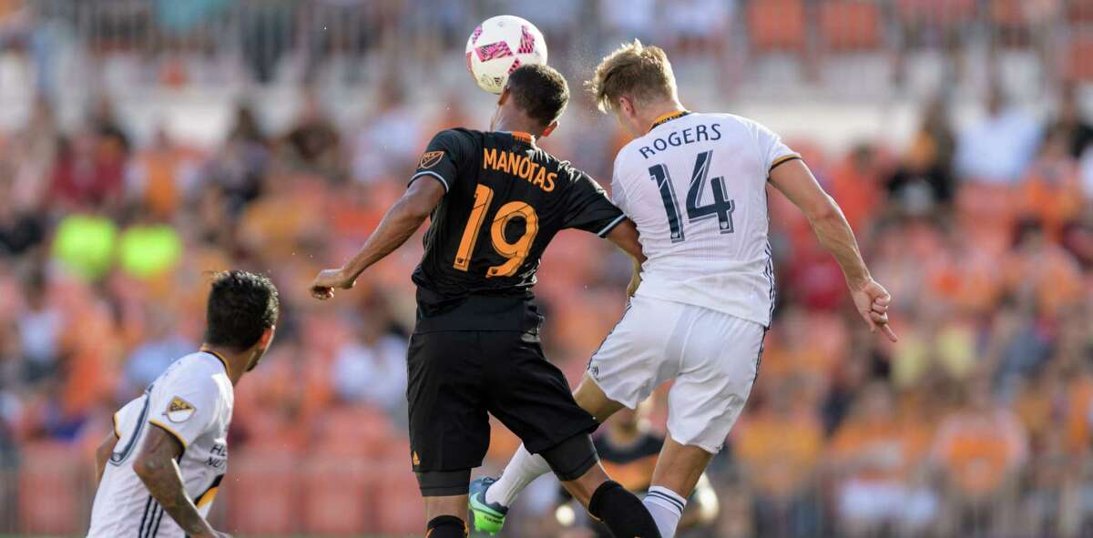 Mauro Manotas (19) of the Houston Dynamo wins a header over Robbie Rogers (14) of the LA Galaxy in the first half of an MLS game on Sunday, October 16, 2016 at BBVA Compass Stadium in Houston Texas.