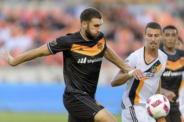 Will Bruin (12) of the Houston Dynamo battles Daniel Steres (44) of the LA Galaxy for the ball in the first half of an MLS game on Sunday, October 16, 2016 at BBVA Compass Stadium in Houston Texas.