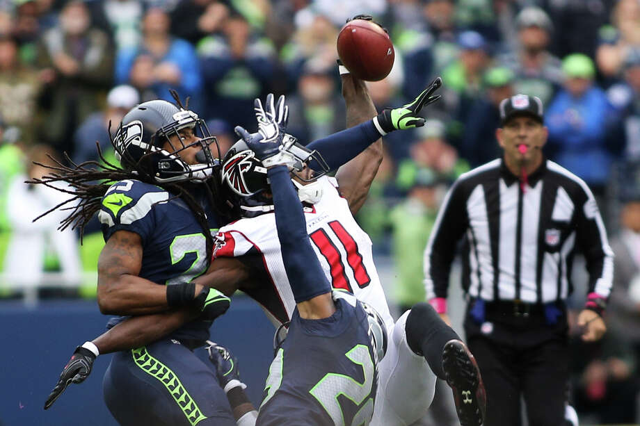 Seahawks corner back Richard Sherman breaks up a long pass meant for Falcons wide receiver Julio Jones on fourth down in the fourth quarter at CenturyLink Field, Sunday, Oct. 16, 2016. Photo: GRANT HINDSLEY, SEATTLEPI.COM / SEATTLEPI.COM