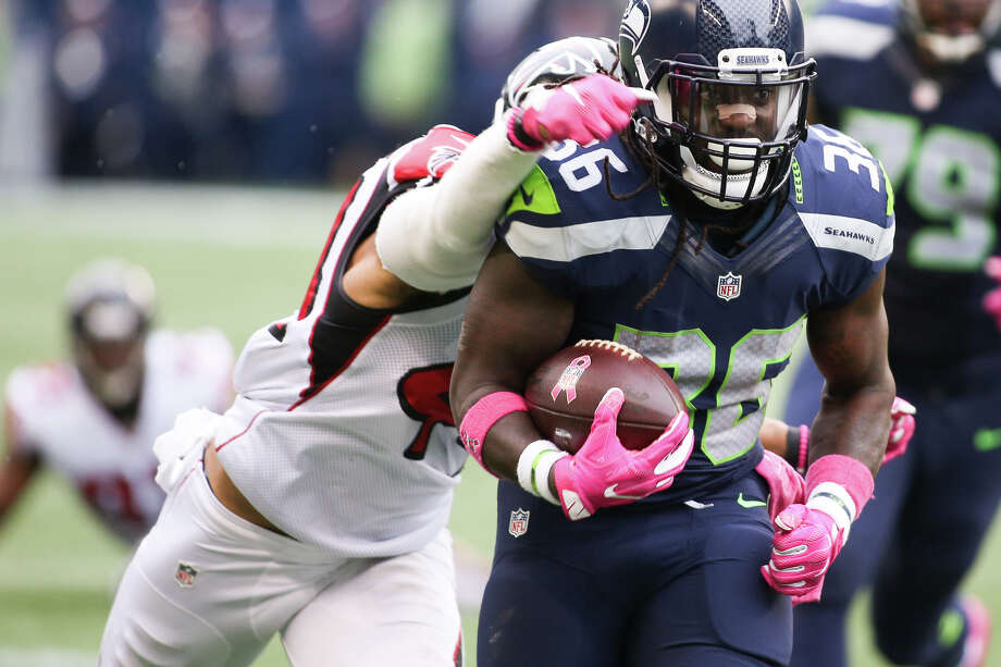 Seahawks running back Alex Collins runs the ball in the second half while playing the Atlanta Falcons at CenturyLink Field, Sunday, Oct. 16, 2016. Photo: GRANT HINDSLEY, SEATTLEPI.COM / SEATTLEPI.COM