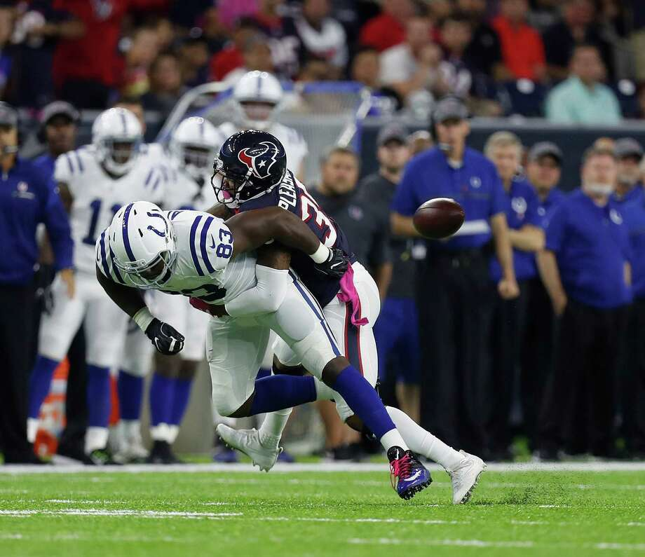 Indianapolis Colts tight end Dwayne Allen (83) is brought down by Houston Texans defensive back Eddie Pleasant (35) during the first quarter of an NFL football game at NRG Stadium, Sunday,Oct. 16, 2016 in Houston. Photo: Karen Warren, Houston Chronicle / 2016 Houston Chronicle