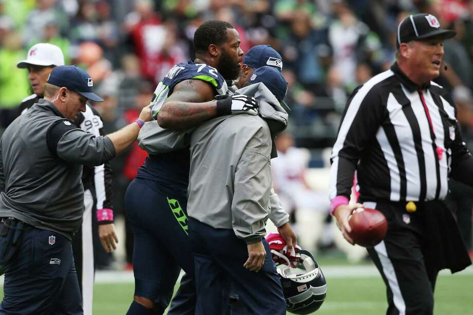 Seahawks defensive lineman Michael Bennett is helped off the field after sustaining a leg injury during the second half of Seattle's game against Atlanta, Sunday Oct. 16, 2016, at CenturyLink Field. Photo: GENNA MARTIN, SEATTLEPI.COM / SEATTLEPI.COM