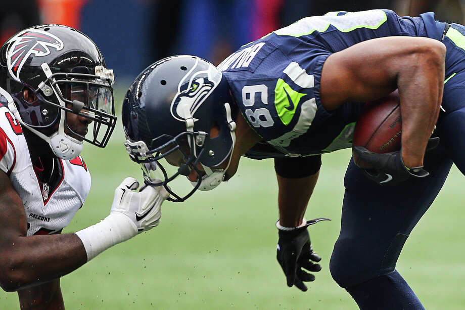 Falcons linebacker LaRoy Reynolds grabs the face mask of Seahawks wide receiver Doug Baldwin during the second half of Seattle's game against Atlanta, Sunday Oct. 16, 2016, at CenturyLink Field. Photo: GENNA MARTIN, SEATTLEPI.COM / SEATTLEPI.COM