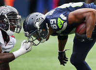 Falcons linebacker LaRoy Reynolds grabs the face mask of Seahawks wide receiver Doug Baldwin during the second half of Seattle's game against Atlanta, Sunday Oct. 16, 2016, at CenturyLink Field.