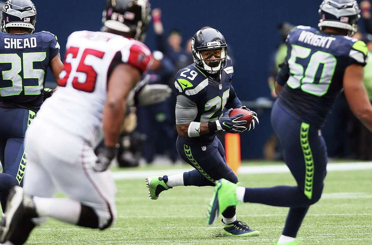 Seahawks safety Earl Thomas (29) runs the ball after making a game-saving interception at the end of the 4th quarter of Seattle's game against Atlanta, Sunday Oct. 16, 2016, at CenturyLink Field.