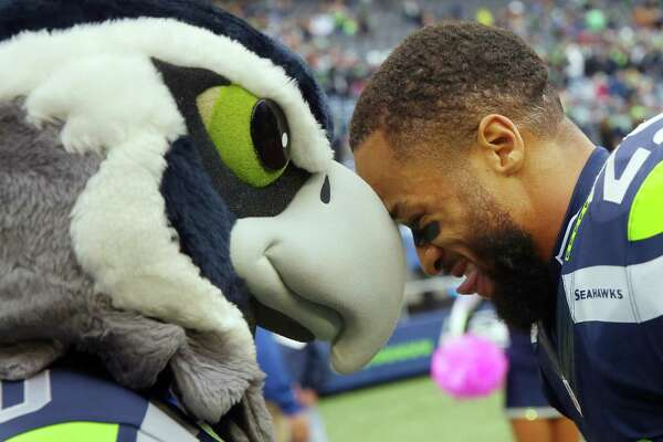 Seahawks safety Earl Thomas celebrates with mascot Blitz after winning 26-24 against the Atlanta Falcons, Sunday Oct. 16, 2016, at CenturyLink Field.