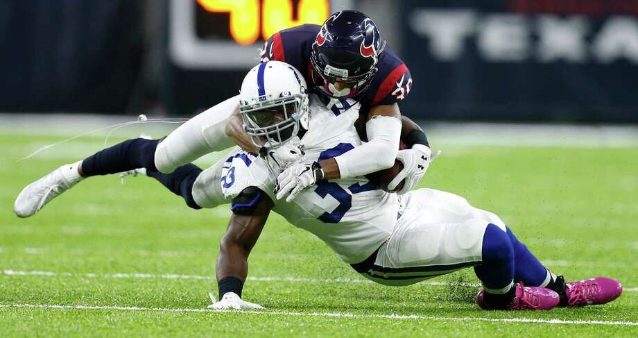 Houston Texans cornerback Kevin Johnson (30) stops Indianapolis Colts running back Robert Turbin (33) during the second quarter of an NFL football game at NRG Stadium on Sunday, Oct. 16, 2016, in Houston. Photo: Brett Coomer, Houston Chronicle / © 2016 Houston Chronicle