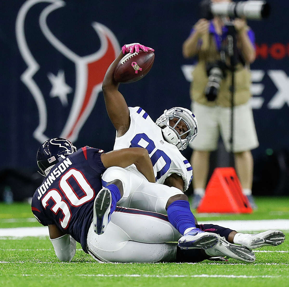 Indianapolis Colts wide receiver Chester Rogers (80) gets stopped by Houston Texans cornerback Kevin Johnson (30) during the second quarter of an NFL football game at NRG Stadium, Sunday,Oct. 16, 2016 in Houston.