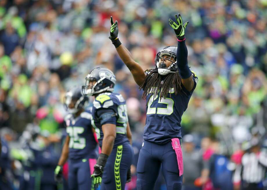 Cornerback Richard Sherman #25 of the Seattle Seahawks gets the crowd going against the Atlanta Falcons at CenturyLink Field on October 16, 2016 in Seattle, Washington.  (Photo by Jonathan Ferrey/Getty Images) Photo: Jonathan Ferrey/Getty Images