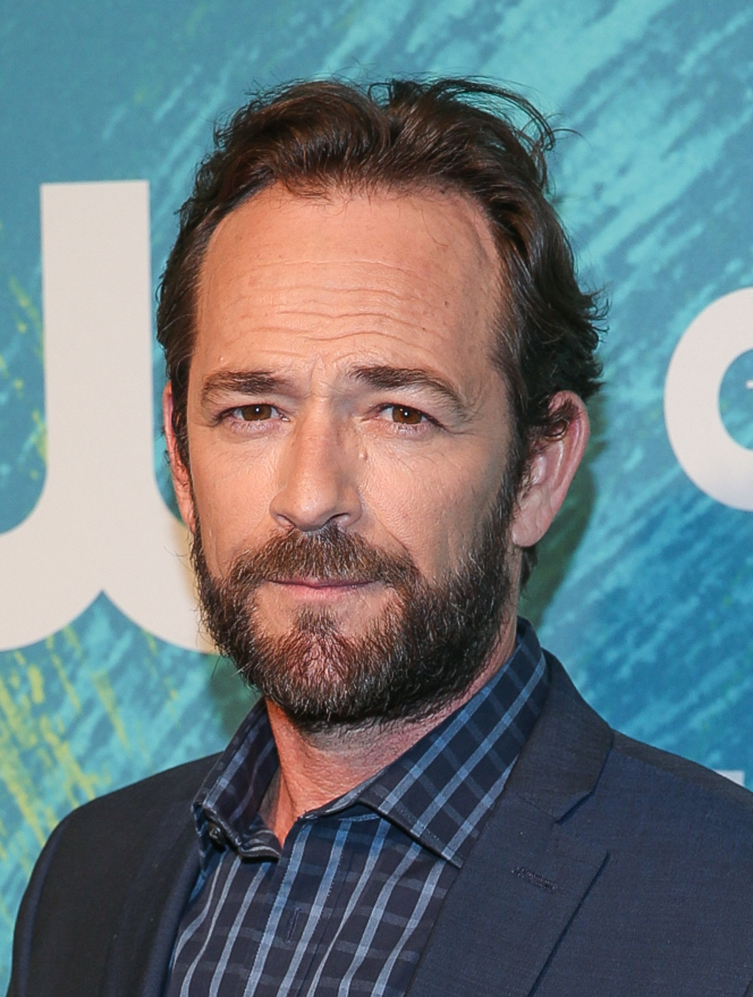 Twitter flips over Luke Perry on the cover of AARP