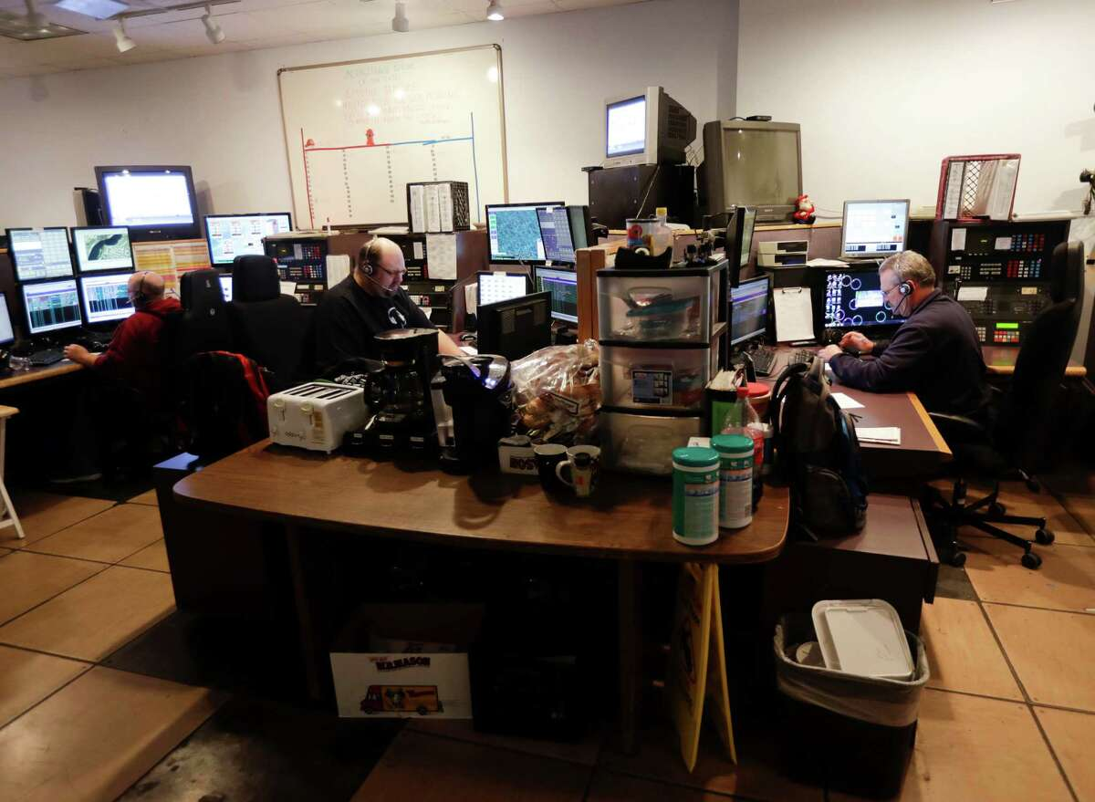 In this Thursday, Oct. 13, 2016 phjoto, communications officers work in the 911 dispatch center at the Rensselaer County Public Safety Building in Troy, N.Y. New York trails other states in modernizing its 911 systems to handle greater cellphone use, in part because lawmakers routinely divert money intended for that purpose and use it to plug holes in the state budget. (AP Photo/Mike Groll) ORG XMIT: NYMG301