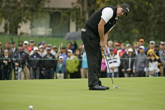 Phil Mickelson makes a birdie putt on the first green of the Silverado Resort North Course during the final round of the Safeway Open PGA golf tournament, Sunday, Oct. 16, 2016, in Napa, Calif. (AP Photo/Eric Risberg)
