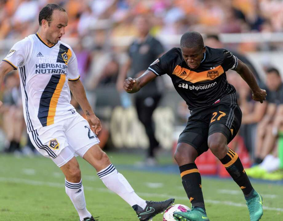 Boniek Garcia, right, of the Dynamo battles for the ball against Landon Donovan, who started for the first time in five appearances for the Galaxy. Photo: Wilf Thorne / © 2016 Houston Chronicle