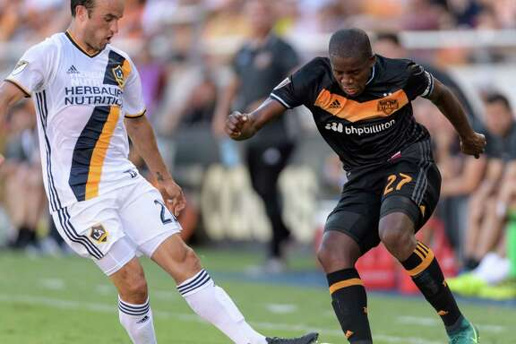 Boniek Garcia, right, of the Dynamo battles for the ball against Landon Donovan, who started for the first time in five appearances for the Galaxy.