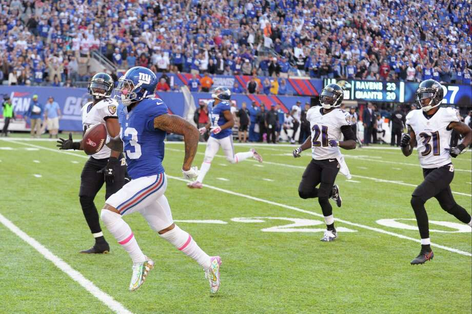 New York Giants wide receiver Odell Beckham (13) runs away form Baltimore Ravens' Anthony Levine (41), Lardarius Webb (21) and Will Davis (31) for a touchdown during the second half of an NFL football game Sunday, Oct. 16, 2016, in East Rutherford, N.J. (AP Photo/Bill Kostroun) ORG XMIT: ERU130 Photo: Bill Kostroun / FR51951 AP