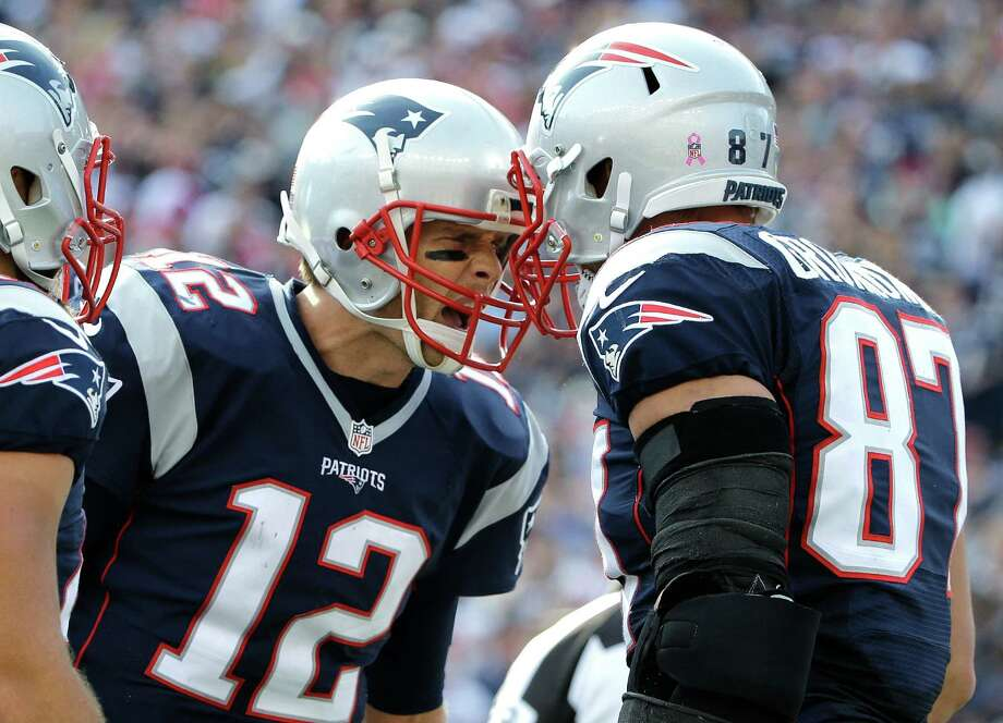 New England Patriots quarterback Tom Brady (12) celebrates his touchdown pass to tight end Rob Gronkowski (87) during the second half of an NFL football game against the Cincinnati Bengals, Sunday, Oct. 16, 2016, in Foxborough, Mass. (AP Photo/Elise Amendola) ORG XMIT: FBO117 Photo: Elise Amendola / Copyright 2016 The Associated Press. All rights reserved.