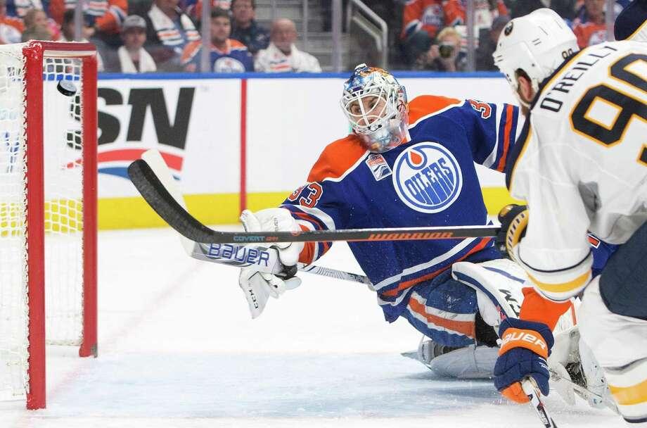 Buffalo Sabres' Ryan O'Reilly (90) scores on Edmonton Oilers' goalie Cam Talbot (33) during first period NHL hockey action in Edmonton, Alberta, Sunday Oct. 16, 2016. (Jason Franson/The Canadian Press via AP) ORG XMIT: EDM104 Photo: Jason Franson / The Canadian Press