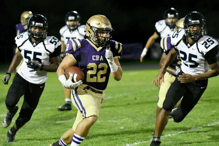 CBA's Nick DeNicola, center, draws a host of Albany defenders during their football game on Friday, Sept. 9, 2016, at Christian Brothers Academy in Colonie, N.Y. (Cindy Schultz / Times Union) Photo: Cindy Schultz / Albany Times Union
