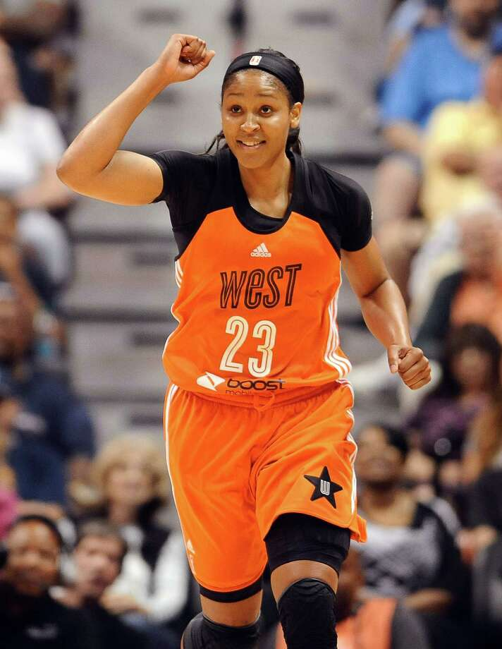 West's Maya Moore, of the Minnesota Lynx, reacts in the final seconds the WNBA All-Star basketball game, Saturday, July 25, 2015, in Uncasville, Conn. West won 117-112. Moore was the game's MVP. (AP Photo/Jessica Hill) ORG XMIT: CTJH112 Photo: Jessica Hill / FR125654 AP