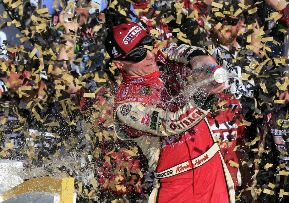 NASCAR driver Kevin Harvick celebrates in victory lane after winning a Sprint Cup series auto race at Kansas Speedway in Kansas City, Kan., Sunday, Oct. 16, 2016. (AP Photo/Orlin Wagner) Photo: Orlin Wagner, STF / Copyright 2016 The Associated Press. All rights reserved.