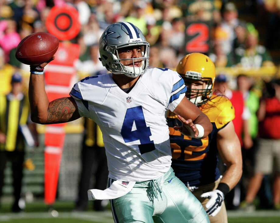 Dallas Cowboys' Dak Prescott throws during the first half of an NFL football game against the Green Bay Packers Sunday, Oct. 16, 2016, in Green Bay, Wis. (AP Photo/Mike Roemer) Photo: Mike Roemer, FRE / FR155603 AP