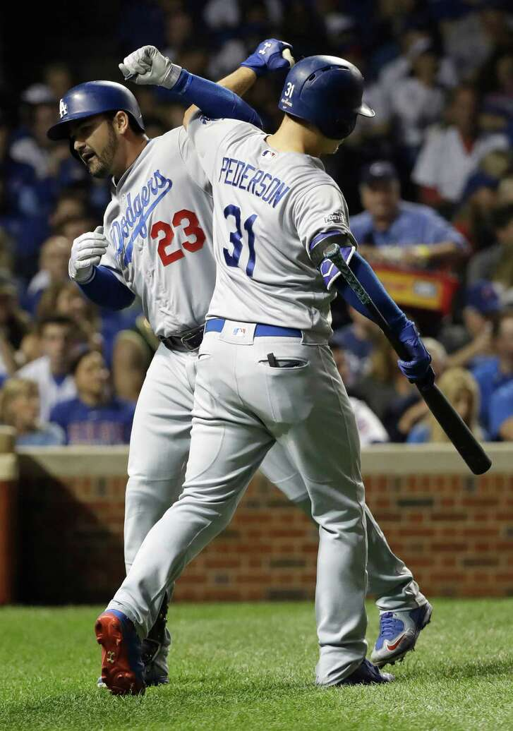 The Dodgers' Adrian Gonzalez (23) celebrates with Joc Pederson after accounting for all the scoring with a second-inning homer off Kyle Hendricks.