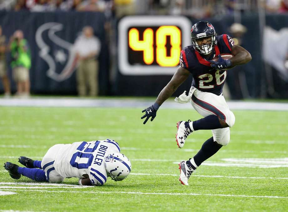 Texans running back Lamar Miller (26) leaves Colts cornerback Darius Butler in his wake on this run in the fourth quarter. Miller finished with a season-high 149 rushing yards in Sunday night's 26-23 overtime victory at NRG Stadium. Photo: Brett Coomer, Staff / © 2016 Houston Chronicle