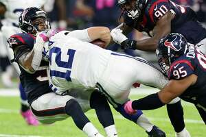 Houston Texans inside linebacker Benardrick McKinney (55), defensive end Jadeveon Clowney (90) and defensive end Christian Covington (95) sack Indianapolis Colts quarterback Andrew Luck (12) in overtime of an NFL football game at NRG Stadium on Sunday, Oct. 16, 2016, in Houston.