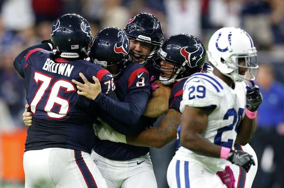 The Texans mob kicker Nick Novak (8) after his 33-yard field goal beat the Colts. Photo: Brett Coomer, Staff / © 2016 Houston Chronicle