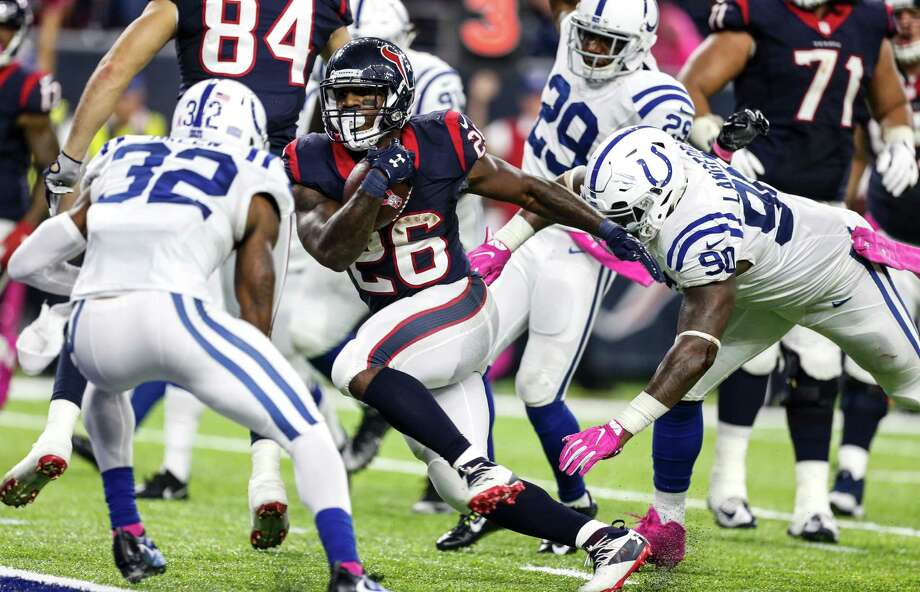 Houston Texans running back Lamar Miller (26) runs past Indianapolis Colts defensive end Kendall Langford (90) on his way to a 10-yard touchdown reception during the fourth quarter of an NFL football game at NRG Stadium on Sunday, Oct. 16, 2016, in Houston. Photo: Brett Coomer, Houston Chronicle / © 2016 Houston Chronicle