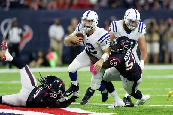 Indianapolis Colts quarterback Andrew Luck (12) is sacked by Houston Texans outside linebacker Whitney Mercilus (59) and defensive end Jadeveon Clowney (90) during the third quarter of an NFL football game at NRG Stadium, Sunday,Oct. 16, 2016 in Houston.