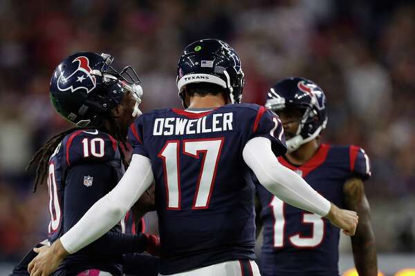 Houston Texans quarterback Brock Osweiler (17) huddles with wide receiver DeAndre Hopkins (10) during the third quarter of an NFL football game at NRG Stadium, Sunday,Oct. 16, 2016 in Houston.