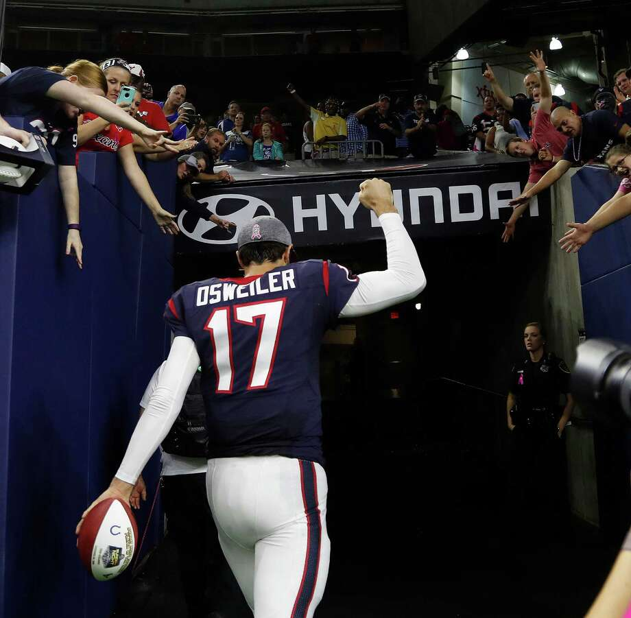 Houston Texans quarterback Brock Osweiler (17) celebrates the Texans win with fan after overtime of an NFL football game at NRG Stadium, Sunday,Oct. 16, 2016 in Houston. Photo: Karen Warren, Houston Chronicle / 2016 Houston Chronicle