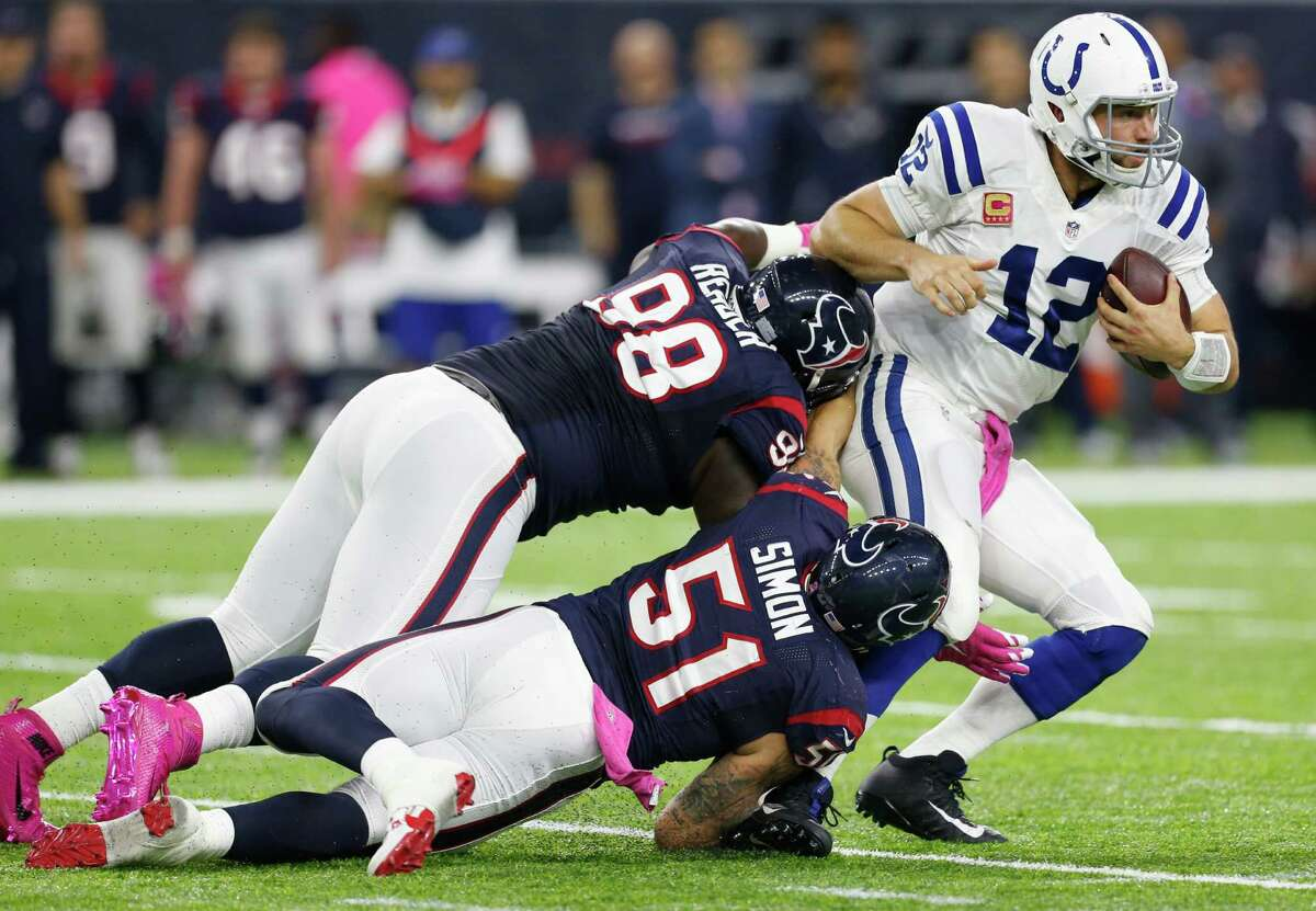 Houston Texans outside linebacker John Simon (51) and Houston Texans nose tackle D.J. Reader (98) stop Indianapolis Colts quarterback Andrew Luck (12) for a 3-yard gain during the third quarter of an NFL football game at NRG Stadium on Sunday, Oct. 16, 2016, in Houston.
