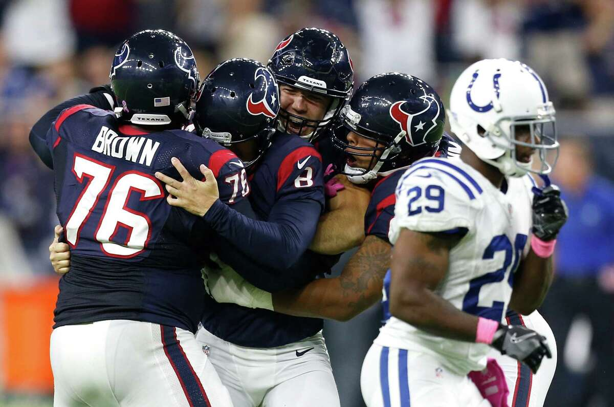 The Houston Texans players mob Houston Texans kicker Nick Novak (8) after he kicked a 33-yard field goal to beat the Indianapolis Colts in overtime of an NFL football game at NRG Stadium on Sunday, Oct. 16, 2016, in Houston.
