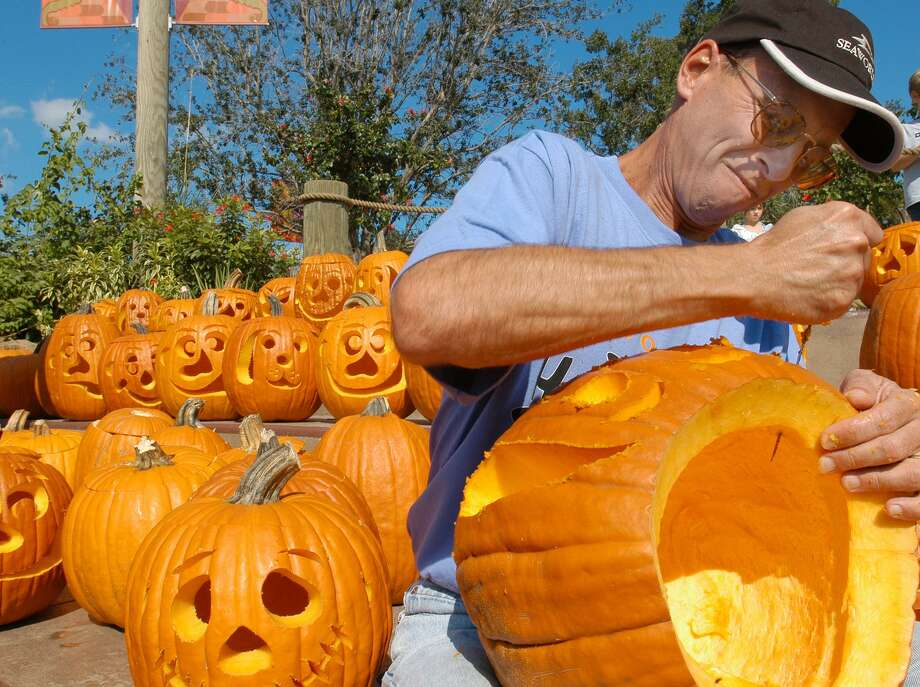 File photo of a man carving a pumpkin. Photo: RICHMOND GIBBS /AP / SEAWORLD ORLANDO