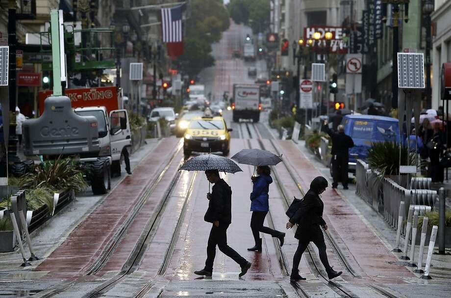 Pedestrians carry umbrellas as they traverse Powell street at Ellis on Friday, Oct. 14, 2016, in San Francisco. The first significant storm of the year hit the Bay Area with gusty winds and rain. Photo: Associated Press