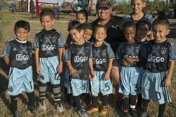 One of the 52 Faces of our Community, Israel Ramirez with some of the youth he coaches. Tuesday 10-04-16  Tim Fischer/Reporter-Telegram