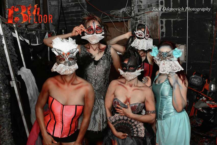 Crowds of cowering Halloween adventurers poured onto the grounds of the 13th Floor Haunted House, where creepy creatures lurk every corner, for a monster bash on Oct. 15, 2016.