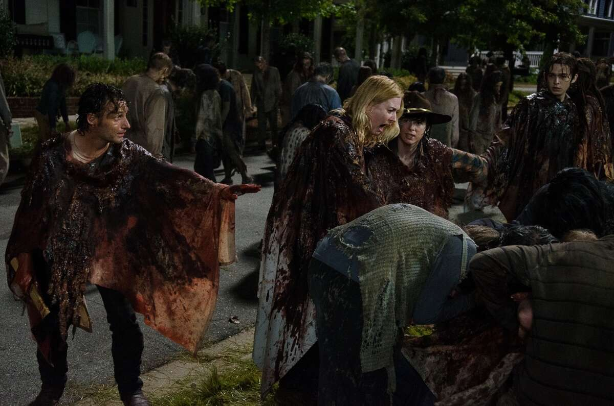 The second half of the sixth season began with Alexandria overrun with walkers. Rick tries to lead people to safety by disguising everyone in walker gore. However, Jessie's son Sam panics and is eaten alive, leaving his mother in shock. When Jessie does not let go of Carl's hand, Rick is forced to chop it off and leave her behind. Jessie's older son, Ron, picks up her gun and aims it at Rick, but Michonne kills him. A shot does go off, however, hitting Carl in the eye. Rick and Michonne run Carl back to the safety of the infirmary. No Way Out