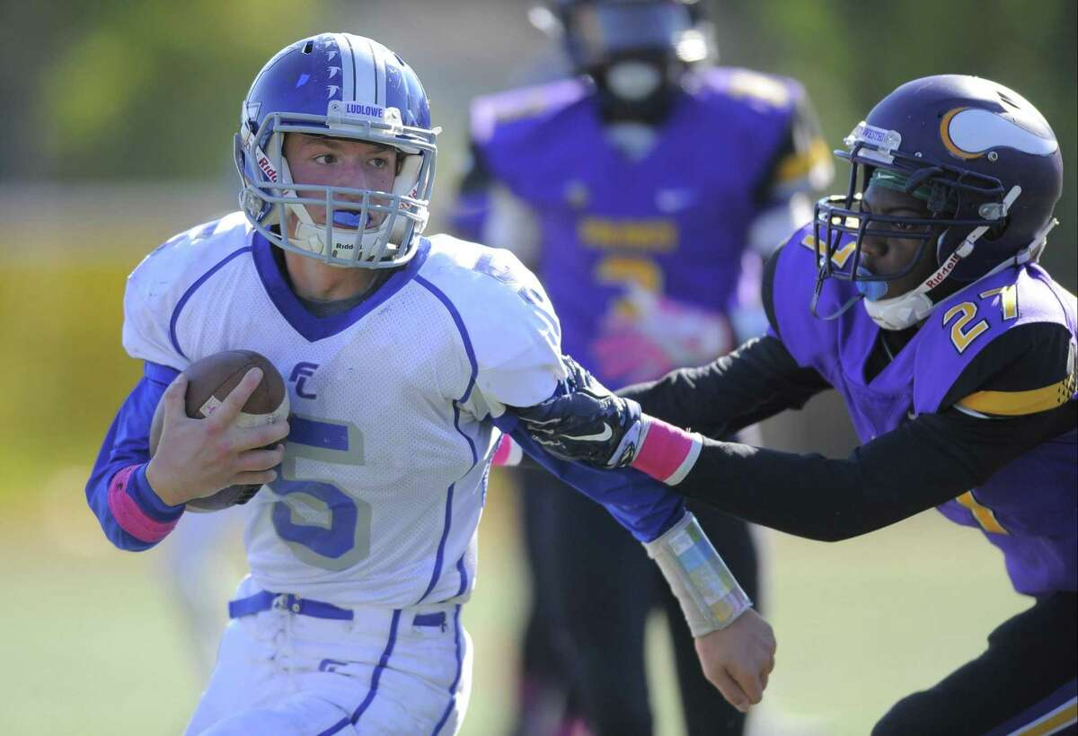 Ludlowe's Brian Howell (5) looks for running room during last Saturday's game against Westhill in Stamford. The Falcons lost 21-0, falling to 0-5 on the season.