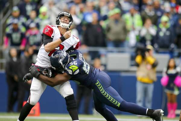 SEATTLE, WA - OCTOBER 16:  Quarterback Matt Ryan #2 of the Atlanta Falcons is hit by defensive end Cliff Avril #56 of the Seattle Seahawks at CenturyLink Field on October 16, 2016 in Seattle, Washington.  (Photo by Jonathan Ferrey/Getty Images)