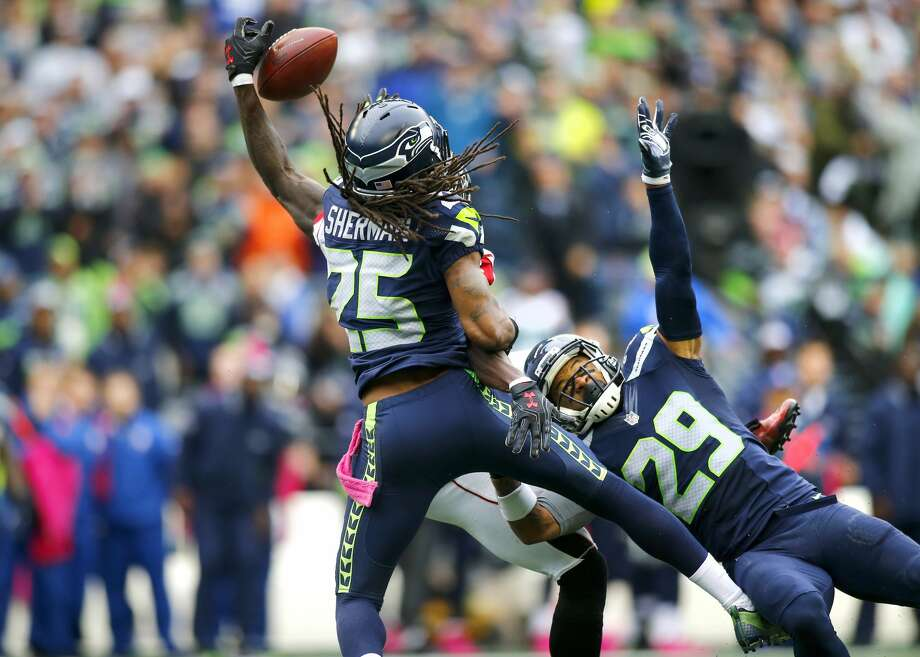 Cornerback Richard Sherman of the Seattle Seahawks and teammate free safety Earl Thomas team up to block a pass intended for Wide receiver Julio Jones #11 of the Atlanta Falcons at CenturyLink Field on October 16, 2016 in Seattle, Washington.  (Photo by Jonathan Ferrey/Getty Images) Photo: Jonathan Ferrey/Getty Images