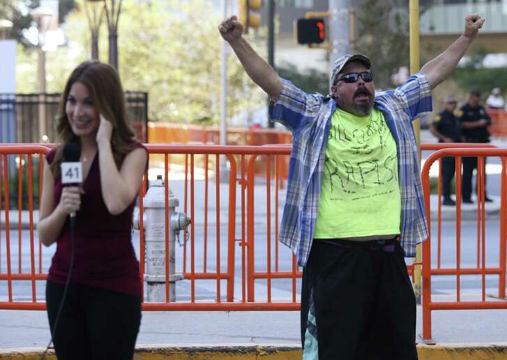 A Donald Trump supporters expresses himself by Univision reporter Mariana Veraza near the Grand Hyatt Hotel, Tuesday, Oct. 11, 2016. Trump attended a fundraiser at the hotel and his visit drew a small number of protestors and supporters.